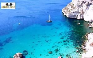 Wild sud sardinia- yoga e vela- vacanza olistica in barca a vela